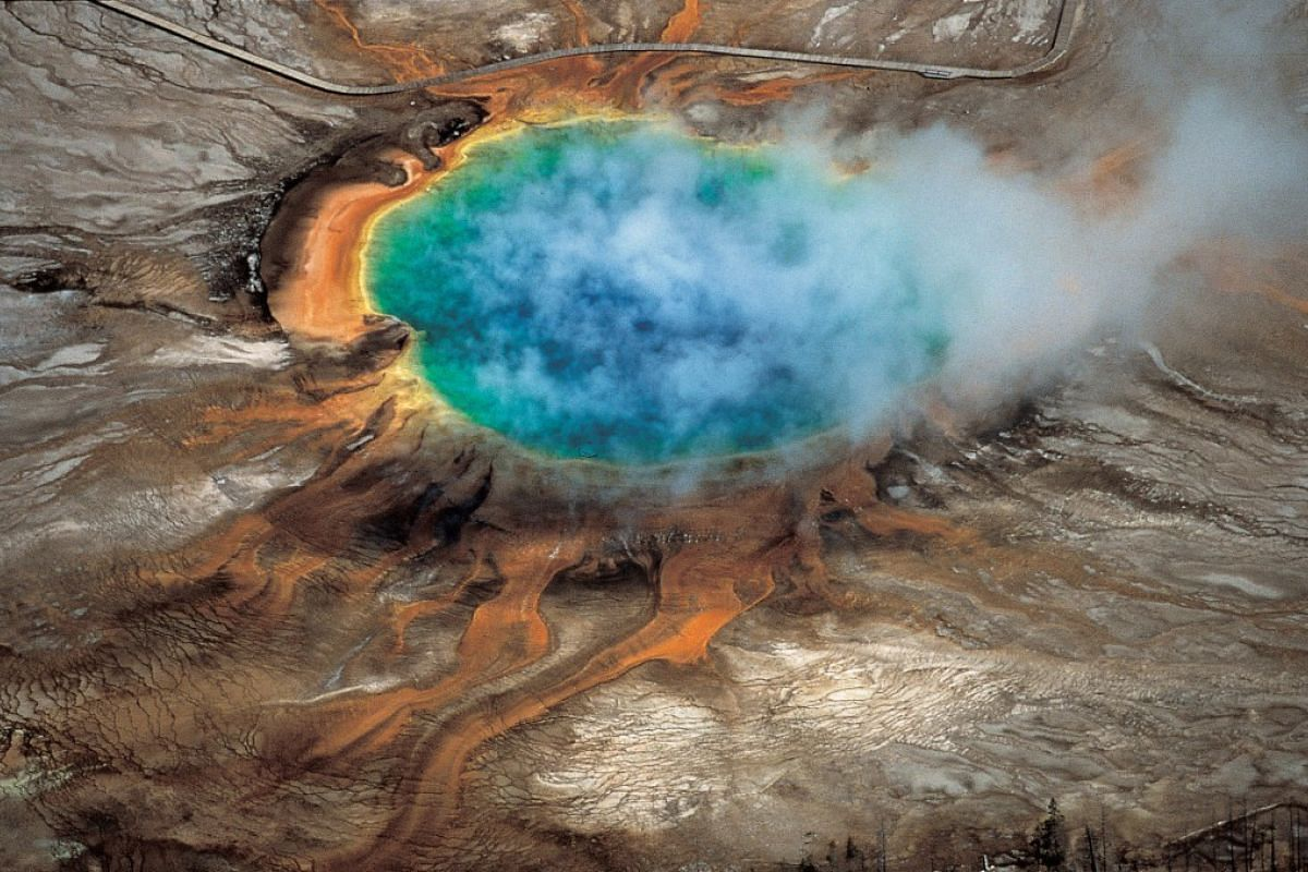 The gorgeous colors of Yellowstone National Park's Grand Prismatic Spring are among the park's myriad hydrothermal features.