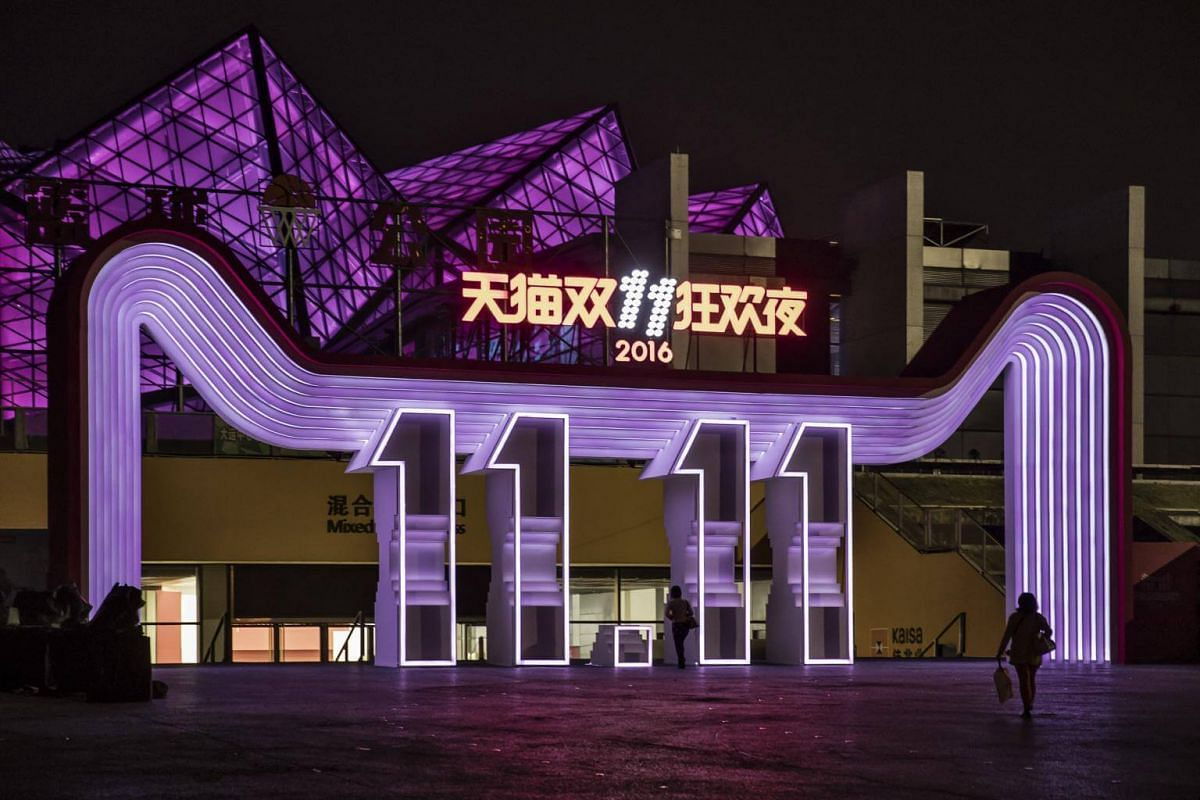 An attendee walks towards the media center during the Alibaba 11.11 Global Shopping Festival Countdown Gala online shopping event in Shenzhen, China on Nov 10, 2016.
