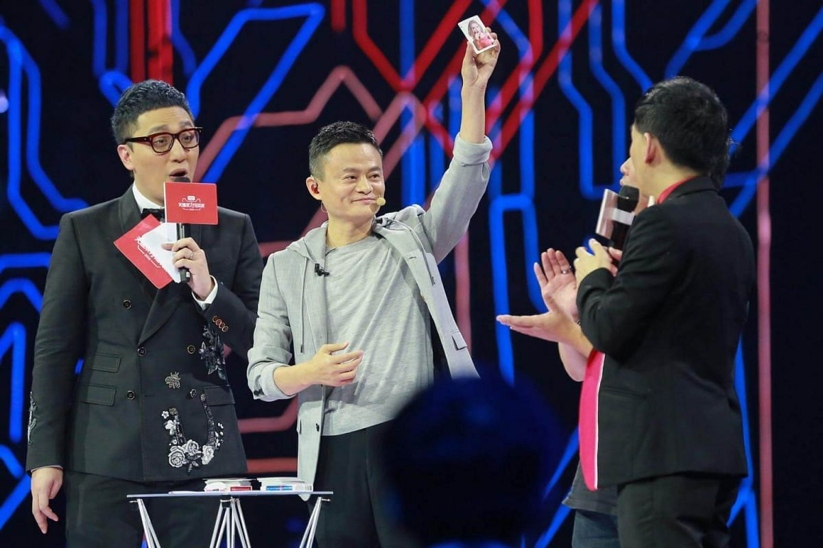 Jack Ma (centre), founder of Alibaba, performing a magic trick at the Alibaba 11.11 Global Shopping Festival Countdown Gala in Shenzhen, Guangdong Province, China, on Nov 11, 2016.