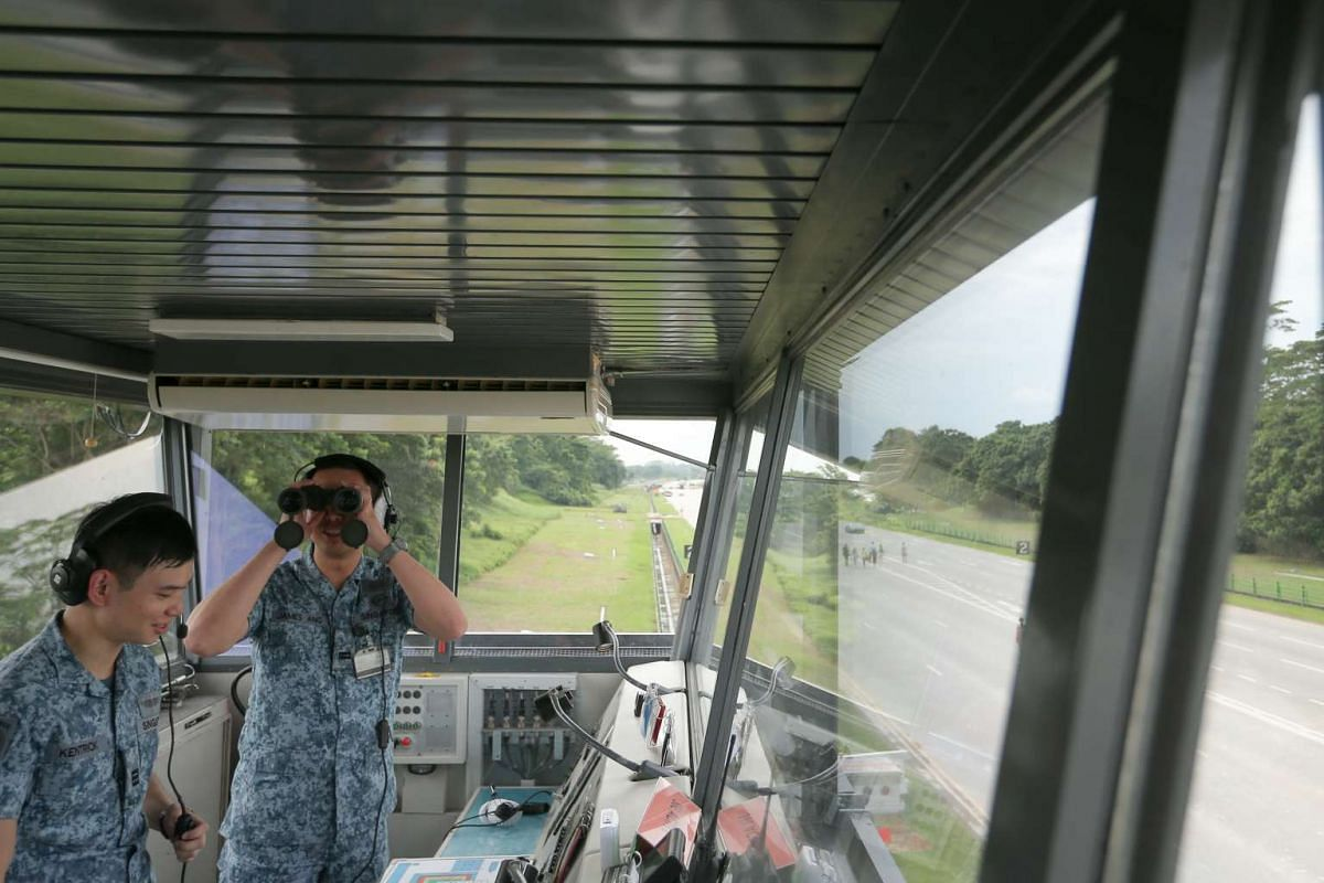 Inside the Mobile Air Traffic Control (MATC) Tower installed along Lim Chu Kang Road, the alternate runway.