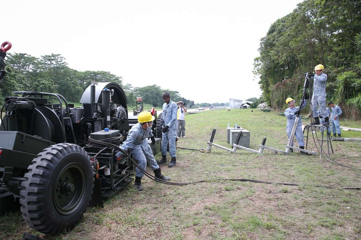 Mobile Arrestor Gear is being prepared at one of the ends of the runway on Nov 11, 2016. It is a mechanical system that rapidly decelrates an aircraft after it touches down.