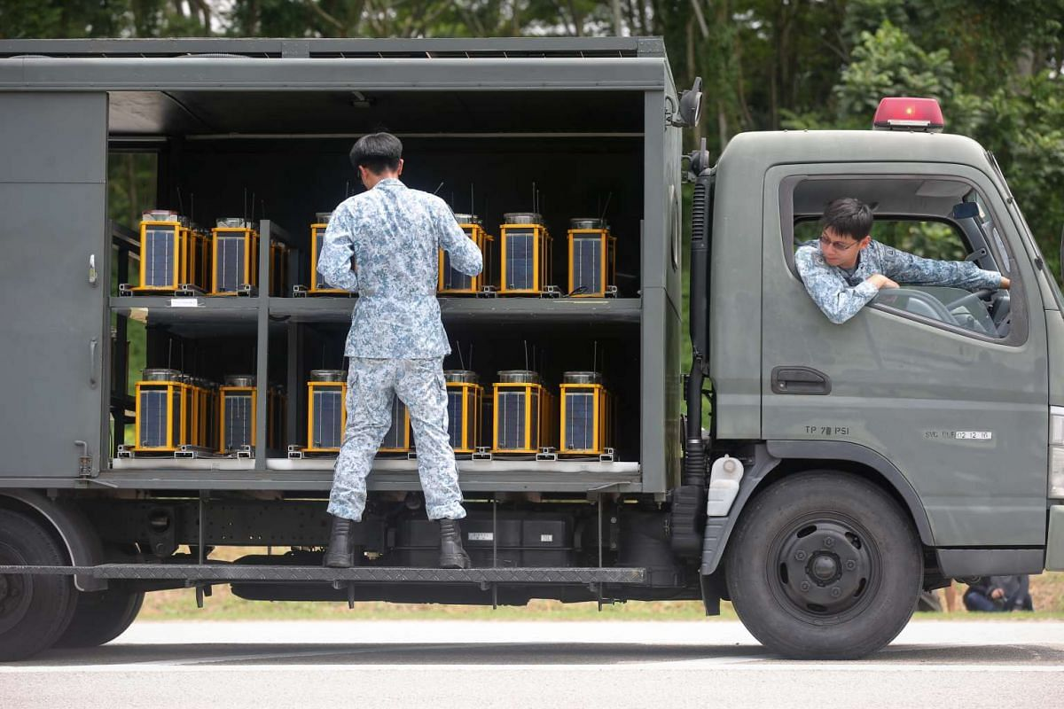 A military vehicle carrying Solar Portable Airfield Lights to be placed 60 metres apart along Lim Chu Kang Road to guide pilots in poor visibility conditions on Nov 11, 2016.