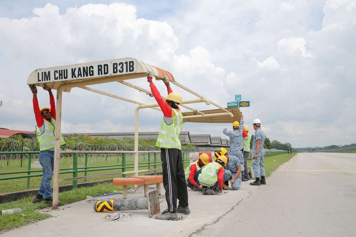The roof of a bus stop along Lim Chu Kang Road being removed as part of RSAF Exercise Torrent on Nov 11, 2016.