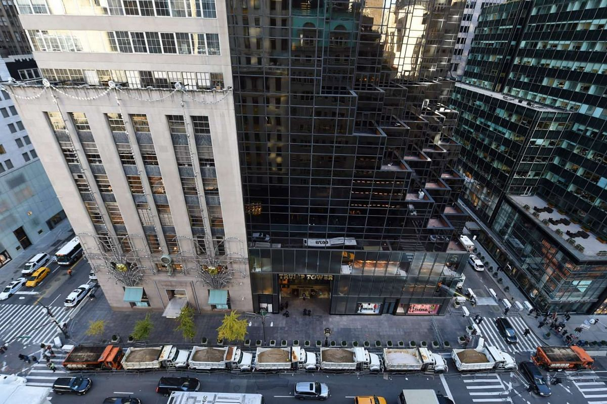 A protective barrier of Sanitation Department trucks are parked in front of Trump Tower on 5th Avenue to provide security to US President-elect Donald Trump in New York on Nov 10, 2016.