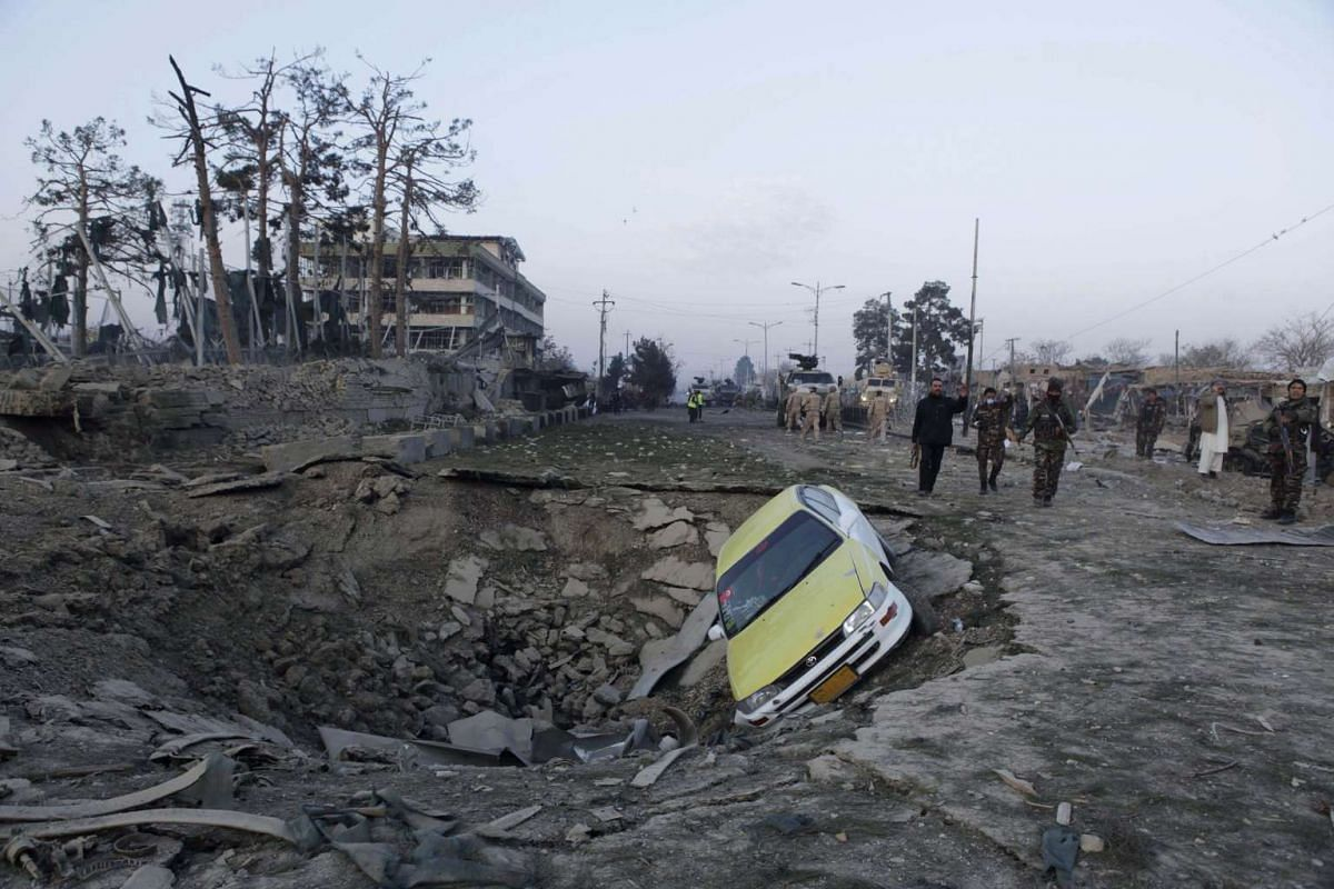 Afghan security forces and Nato troops arrive at the site of explosion near the German consulate office in Mazar-i-Sharif, Afghanistan on Nov 11, 2016.