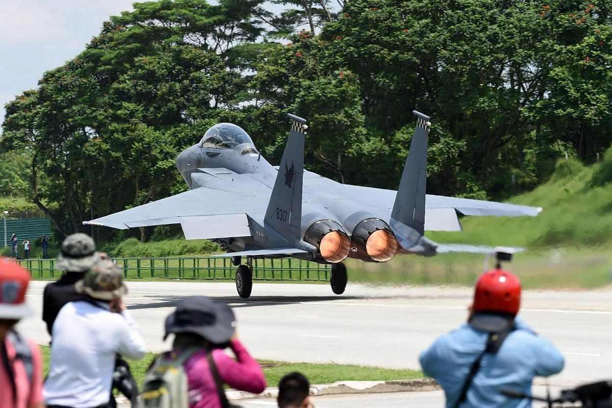 An RSAF F-15SG takes off from Lim Chu Kang Road during a media preview of Exercise Torrent.