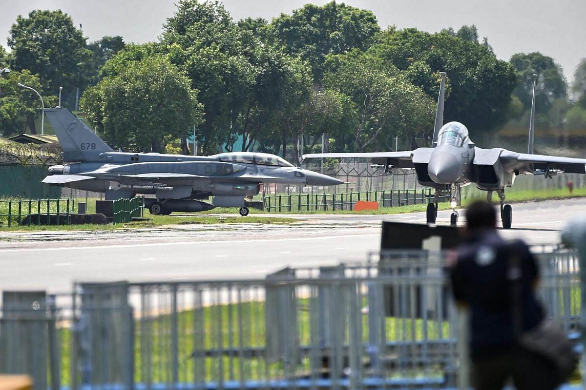 An RSAF F-15SG and F-16 prepare to take off during Exercise Torrent.
