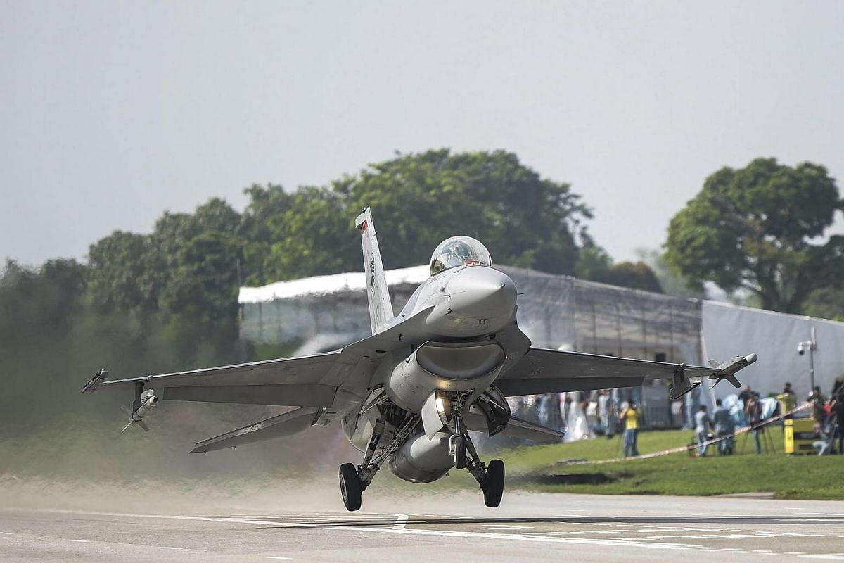 An RSAF F-16 lands on the temporary runway at Lim Chu Kang Road.