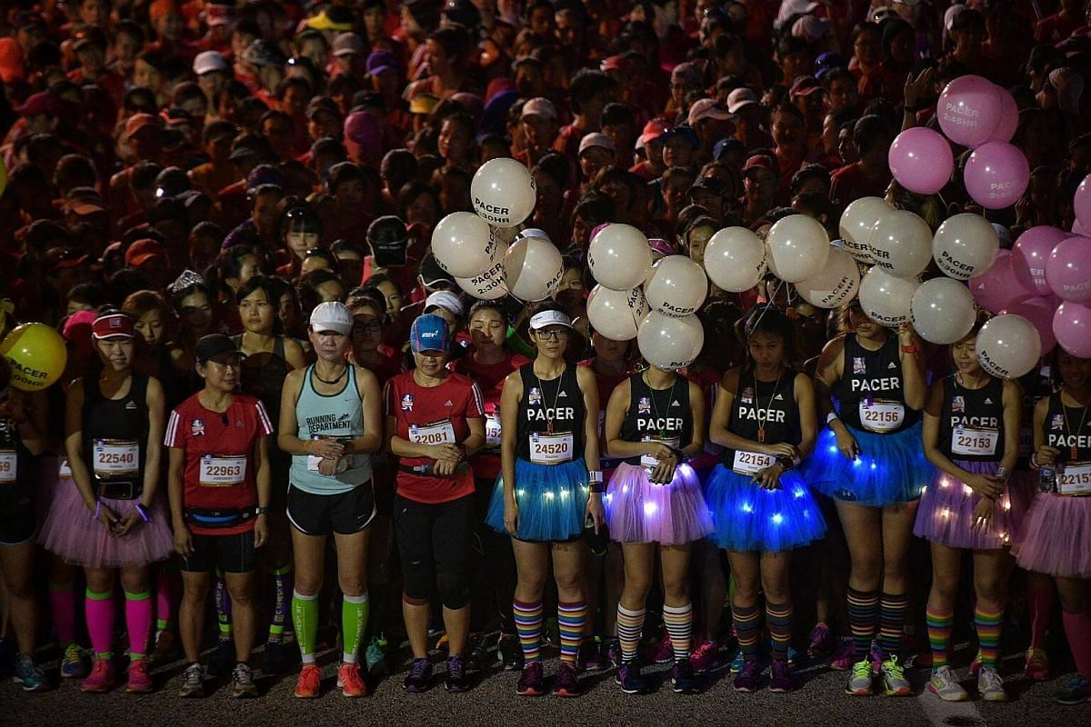 Participants wait at the start point before the 21.1km half marathon flag-off at the Great Eastern Women's Run.