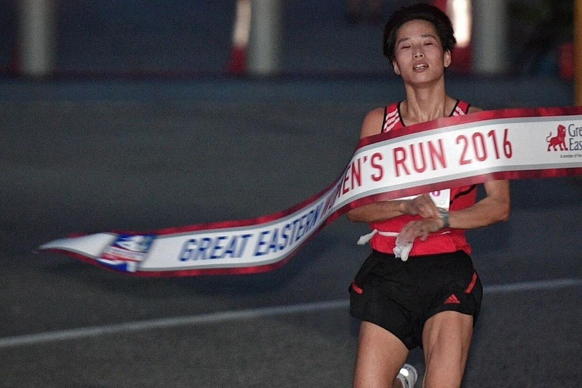 Jo Un Ok of North Korea crosses the finish line in first place during the 21.1km half marathon (elite open category) at the Great Eastern Women's Run.