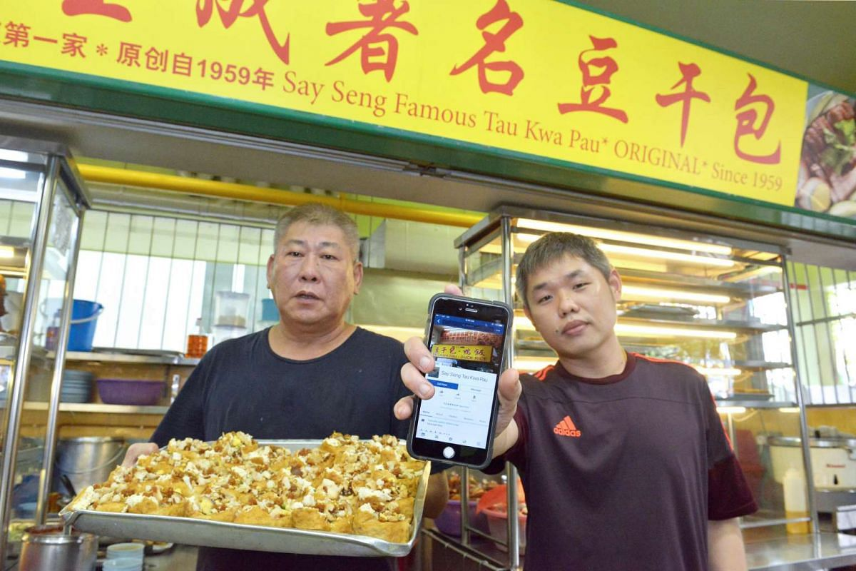 Mr Khoo Lian Hwa and Mr Toh Wei Kwan of Say Seng Tau Kwa Pau, which has a Facebook page and takes orders via Facebook Messenger.