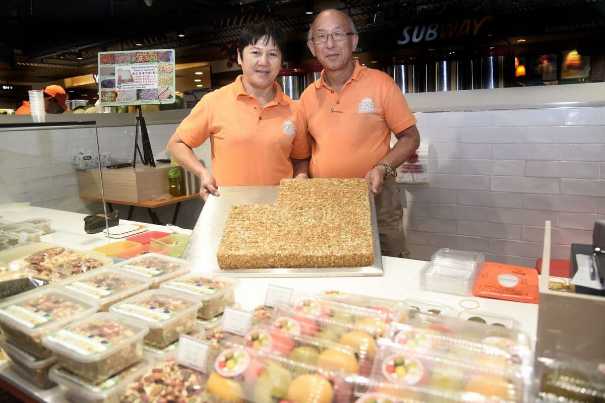 At their stall Kokee Delights, Mr Joseph Koh and his wife Ivy sell a multi-nut cake whose recipe they created.