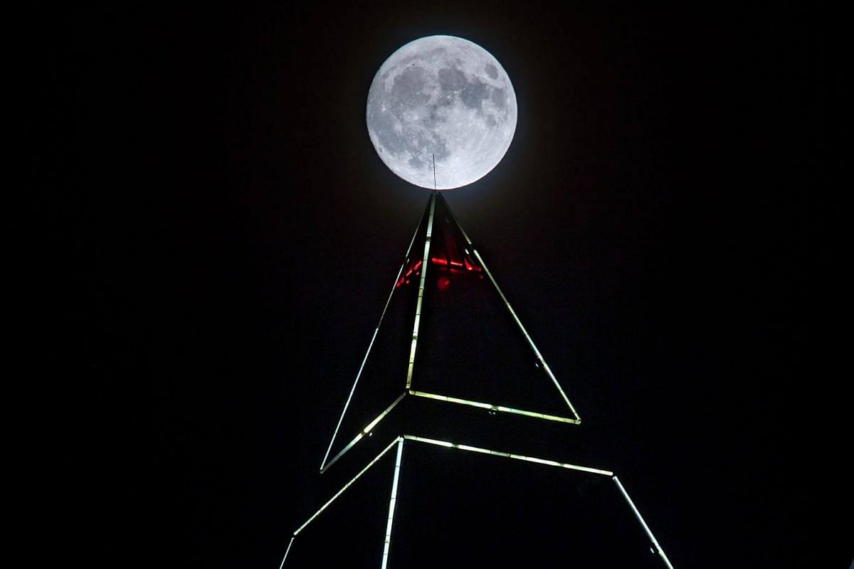 The full moon shining above the pyramidal top of the 256.5m high measuring tower in Frankfurt am Main, Germany, on Nov 13, 2016.