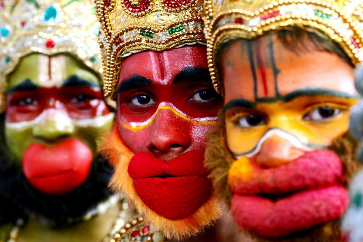 Indian School children in a traditional attire of a characters of Indian epic Ramayan pose for the photographs before their performance, on the eve of children's day celebration at cubbon park, in Bangalore, India, on Nov 13, 2016.