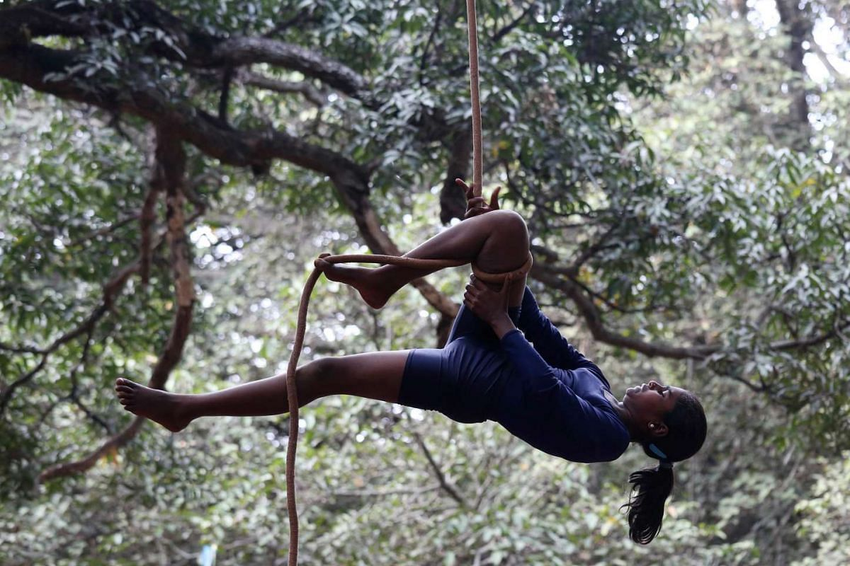 Indian School children performing rope yoga on the eve of children's day celebration at cubbon park, in Bangalore, India, on Nov 13, 2016.