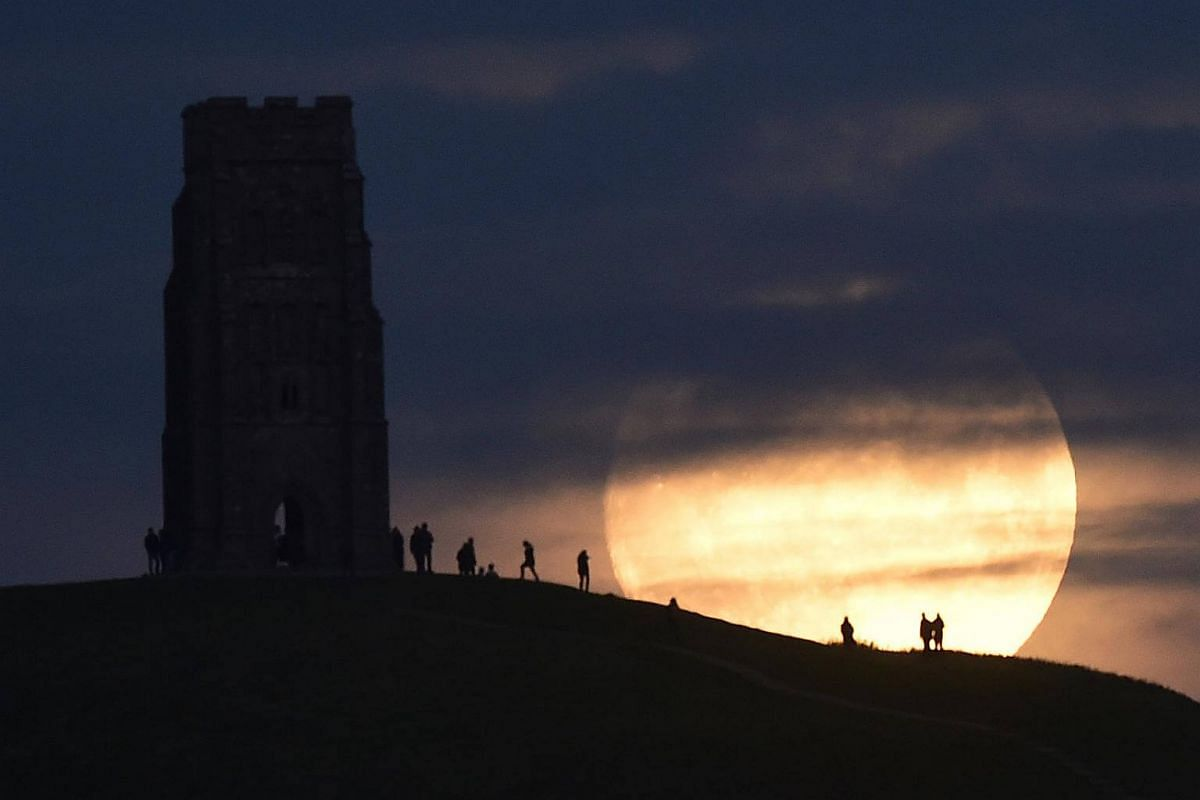 The moon rising near Glastonbury Tor a day before the 'supermoon' spectacle in Glastonbury, Britain, on Nov 13, 2016.