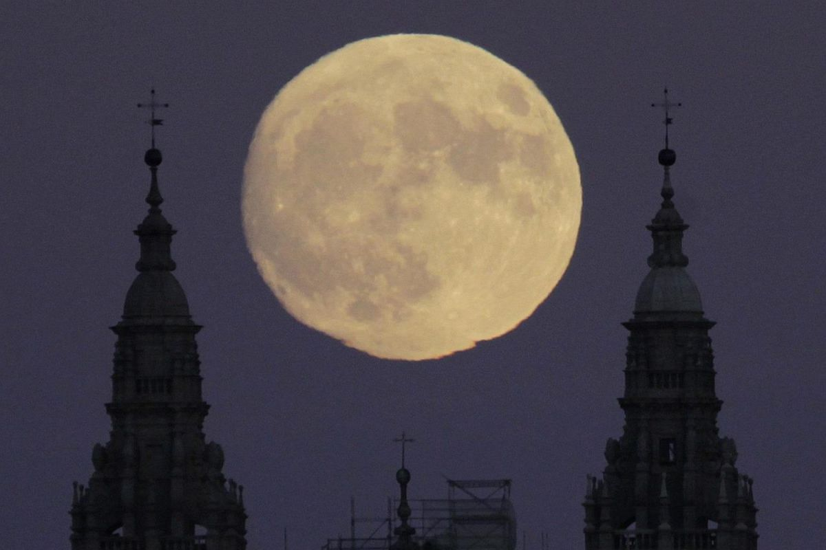 The Santiago's Cathedreal with the moon during the brighter full moon phenomenon in Santiago, Spain, on Nov 13, 2016.