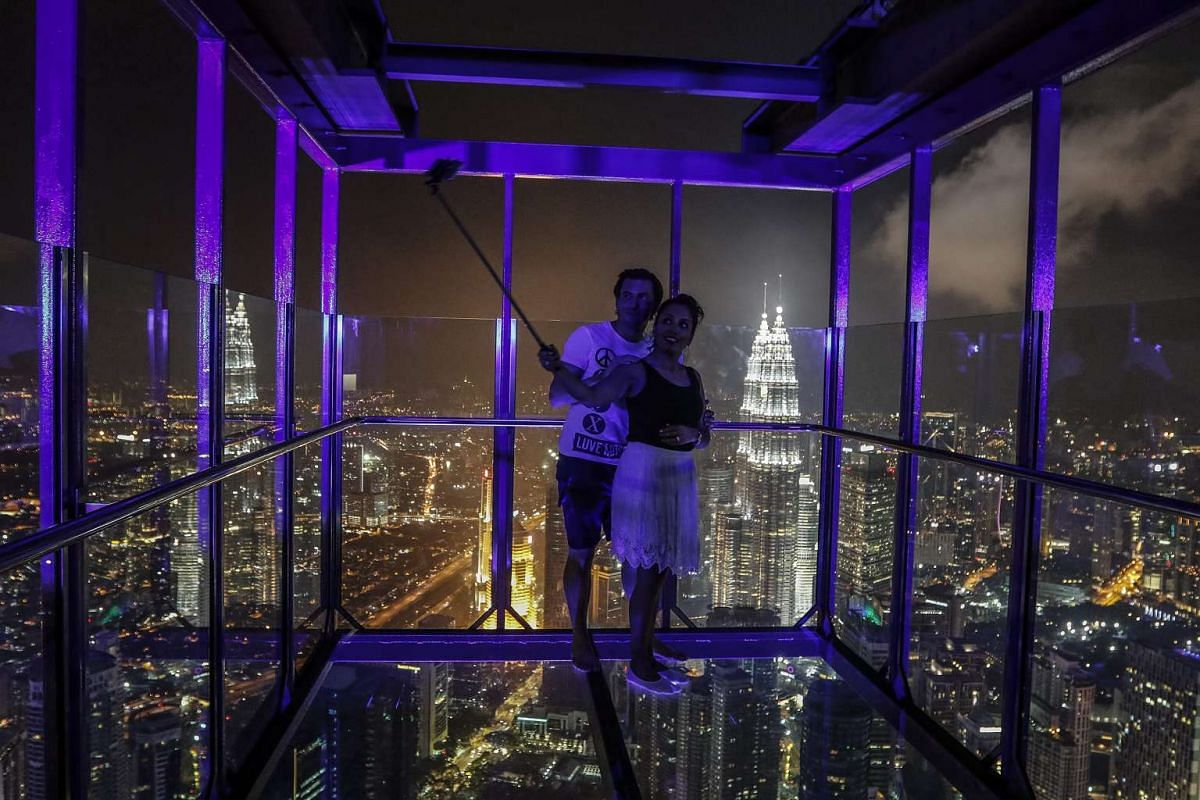 A couple take a selfie inside a skybox (300m above sea level) in Kuala Lumpur during the supermoon night at Kuala Lumpur Tower in Malaysia on Nov 14, 2016.