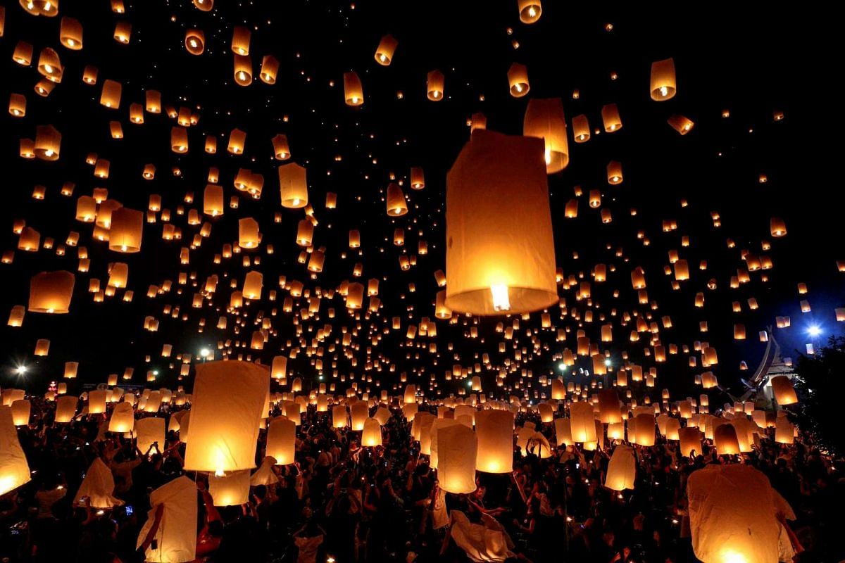 People release floating lanterns during the festival of Yee Peng in the northern capital of Chiang Mai in Thailand on Nov 14, 2016.