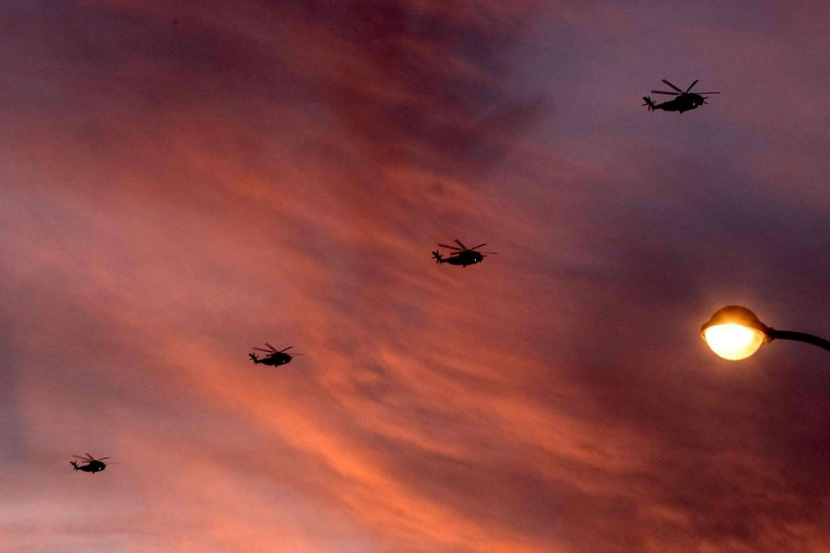 Four Israeli Sikorsky CH-53K helicopters fly over Tel Aviv on Nov 14, 2016, during sunset.