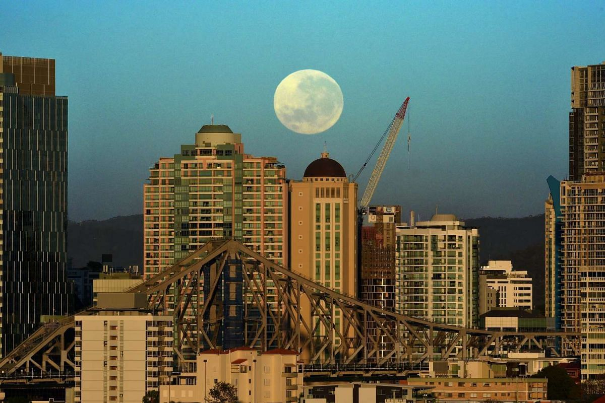 A Supermoon sets over the Brisbane skyline in Australia early on Nov 15, 2016.