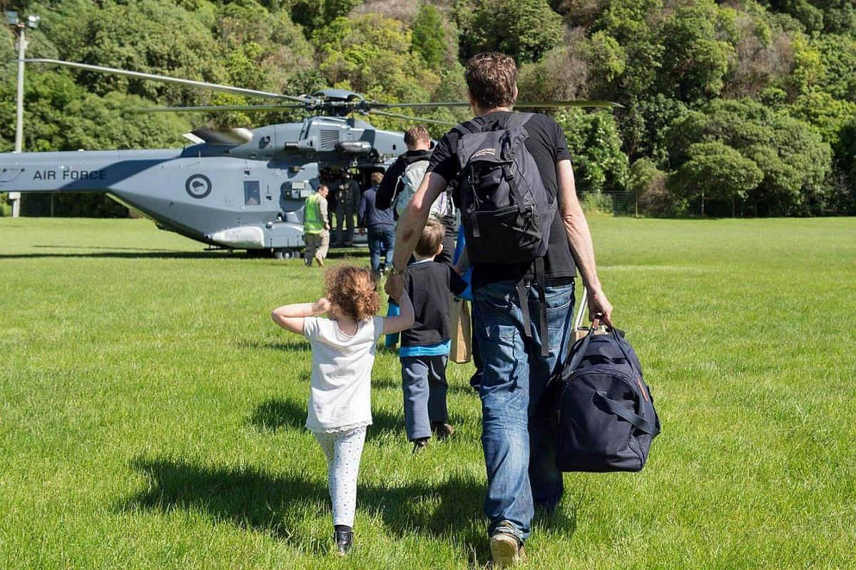A handout photo taken and received on Nov 15, 2016, shows a New Zealand Defence Force helicopter evacuating some of 1,200 of tourists from Kaikoura stranded by a 7.8 earthquake that caused devastation on the east coast of the South Island.