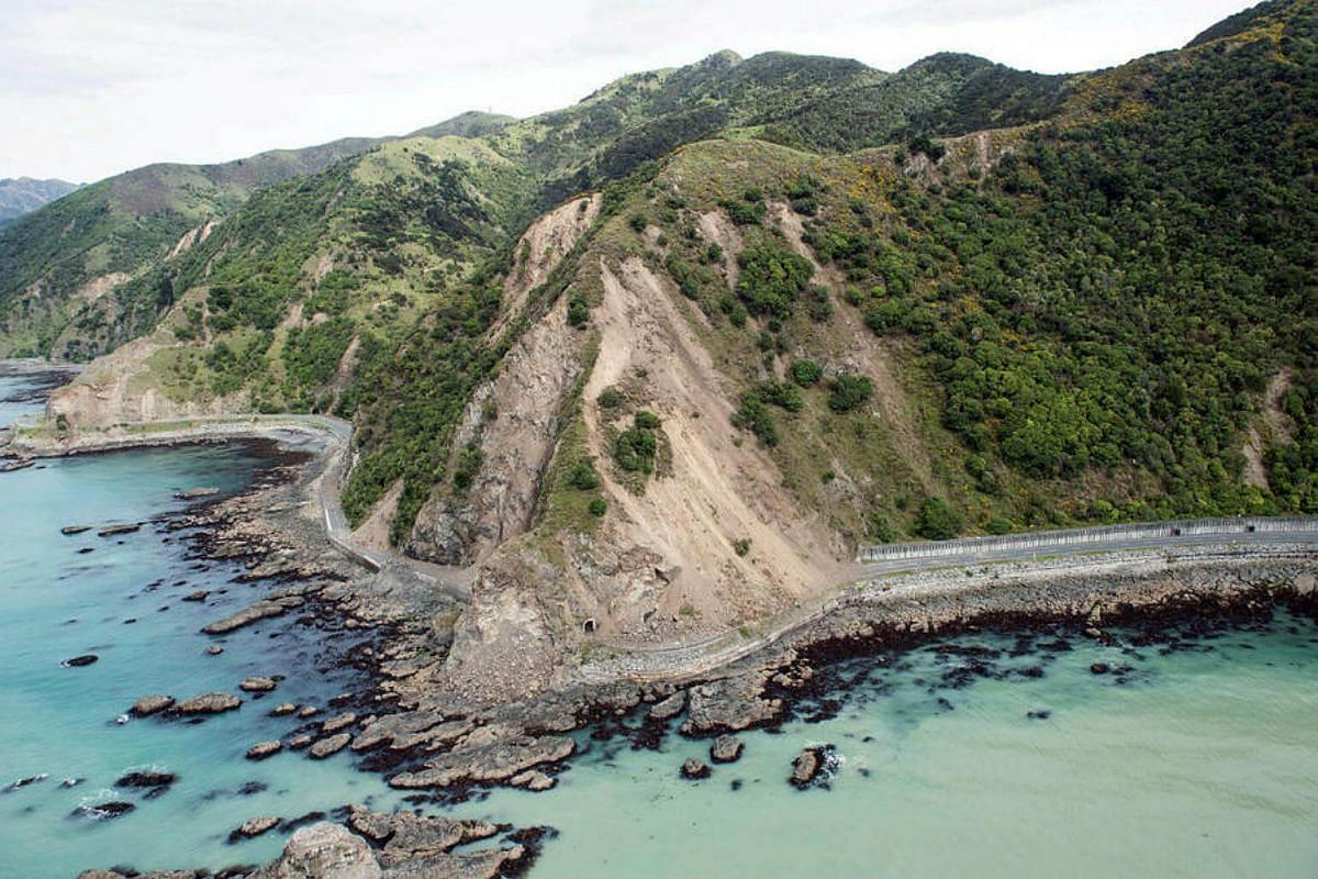 Landslides block State Highway One near Kaikoura on the upper east coast of New Zealand's South Island following an earthquake, on Nov 14, 2016.