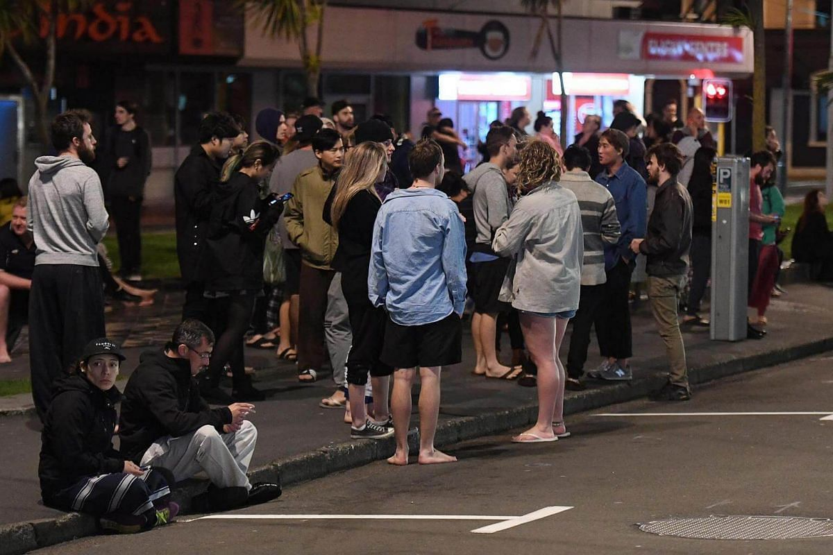 People evacuated from buildings along Dixon Street, Wellington after an earthquake based around Cheviot in the South island shock the capital, New Zealand, on Nov 14, 2016.