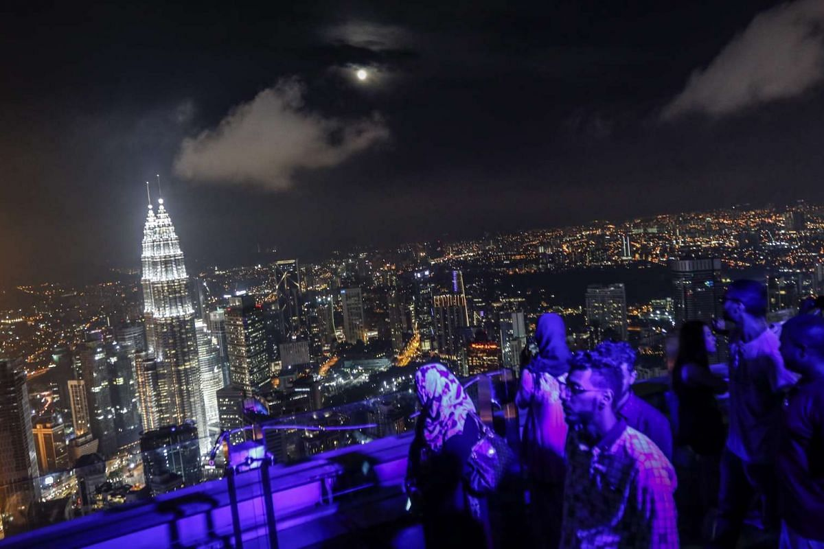 Tourists looking at the night scene from Kuala Lumpur Tower during the supermoon night in Malaysia on Nov 14, 2016.