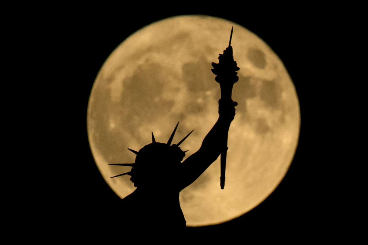 The supermoon is seen above a statue at the top of the Nature and History Museum in Vienna, Austria, on Nov 14, 2016.