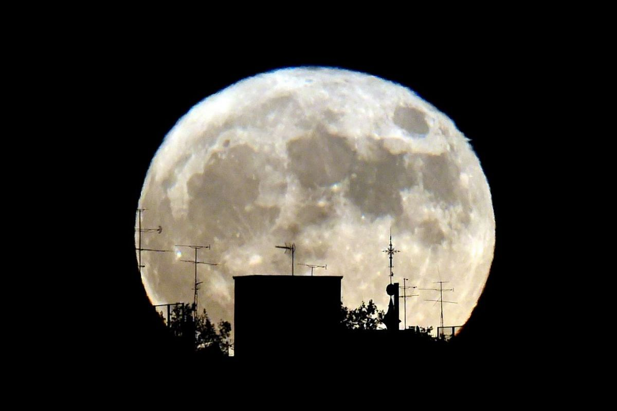 A supermoon rises against the skyline in Madrid on Nov 14, 2016.