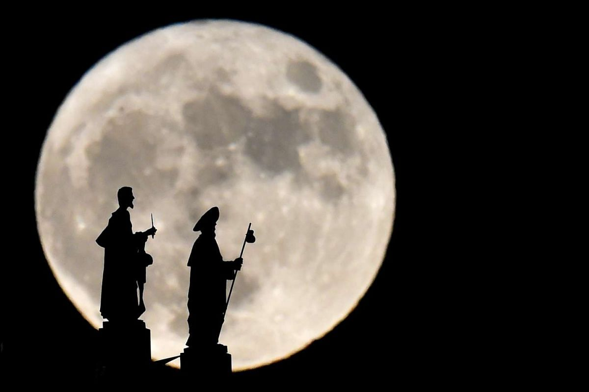 Statues on the Almudena Cathedral silhouetted against the supermoon in Madrid on Nov 14, 2016.