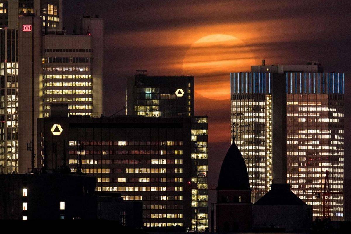 The supermoon is covered by clouds behind the skyline of Frankfurt am Main, Germany, on Nov 14, 2016.