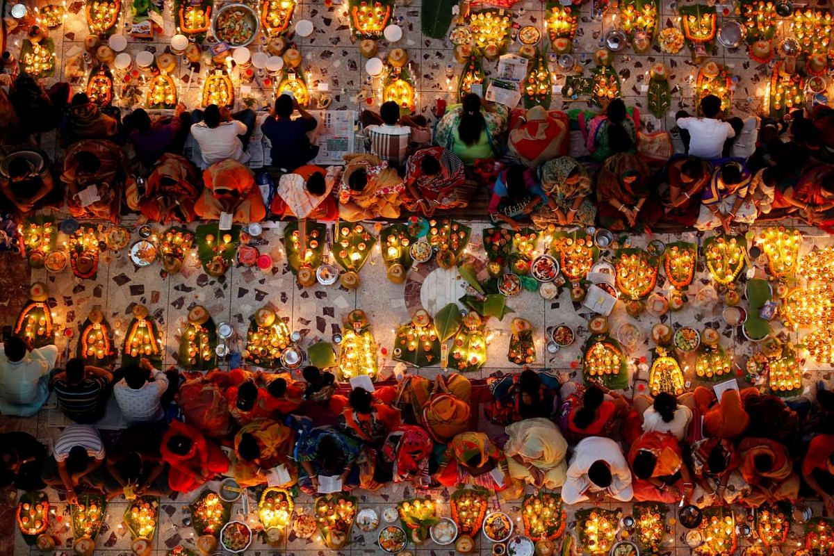 Hindu devotees sit together on the floor of a temple to observe Rakher Upabash for the last day, in Dhaka, Bangladesh, November 15, 2016. PHOTO: REUTERS