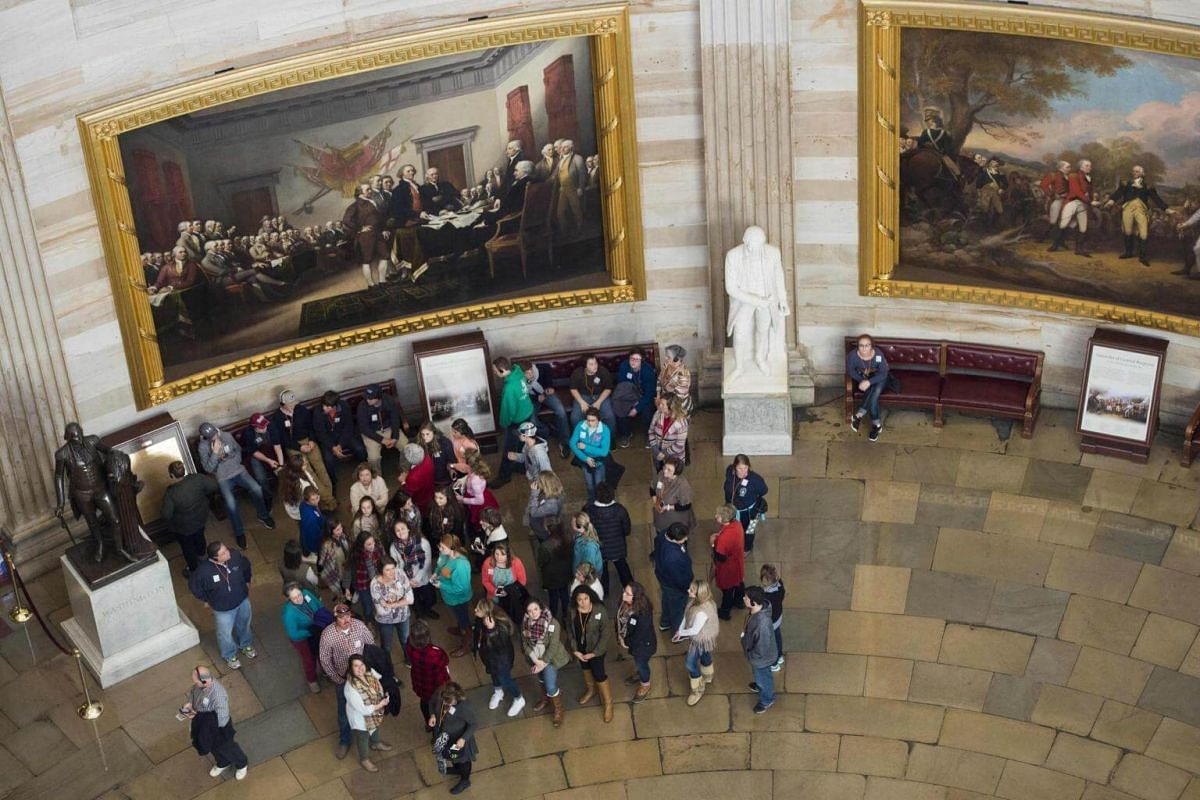 A tour group visits the Capitol Rotunda as seen from the newly-restored Capitol dome at the US Capitol in Washington, DC, on Nov 15, 2016.