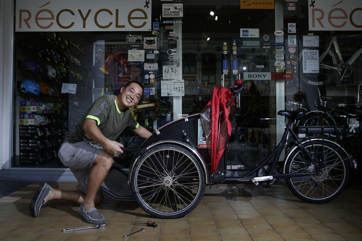 Mr Raymond Cha repairs Cycling Without Age's trishaw for free as a show of support for Ms Bussone's non-profit initiative.