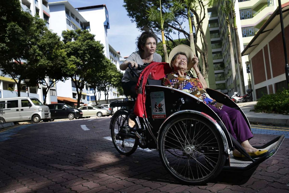Pernille Bussone (left) with her close friend Tan Geok Hak, on a trishaw ride around Jalan Bukit Ho Swee on Oct 12, 2016.