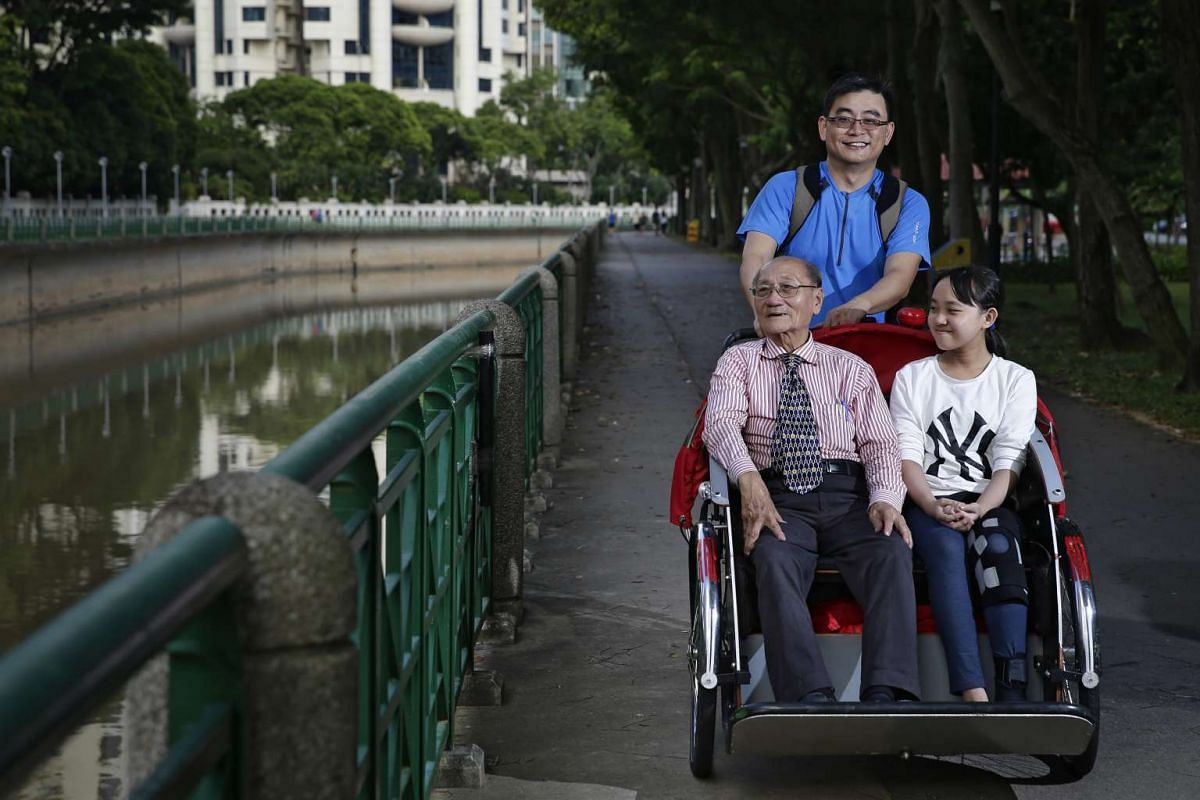 A 40-year-old scientist with a research and development company, riding with Mr Lee Kee Siang, and his granddaughter Janet, at Alexandra park connector on Oct 8, 2016.