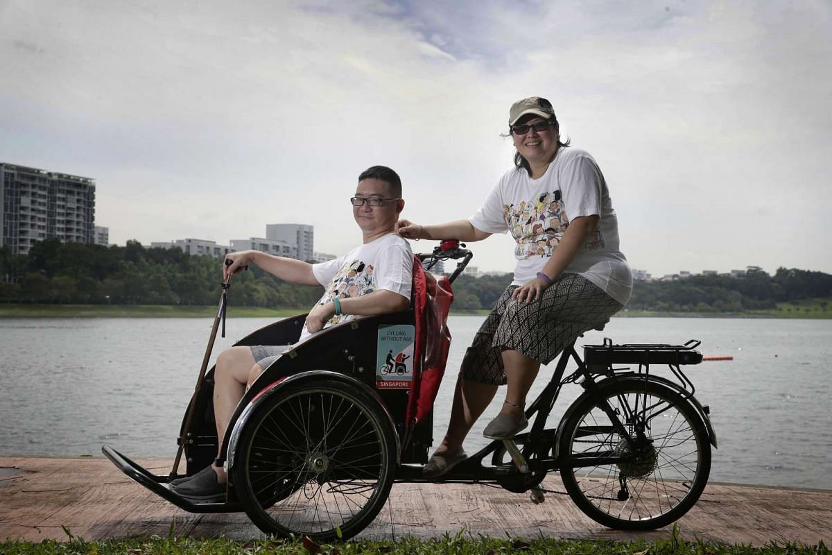 Ms Nancy Chew (right) approached Cycling Without Age to rent the trishaw so that she can take her husband William Tan, out of the house to explore nature.