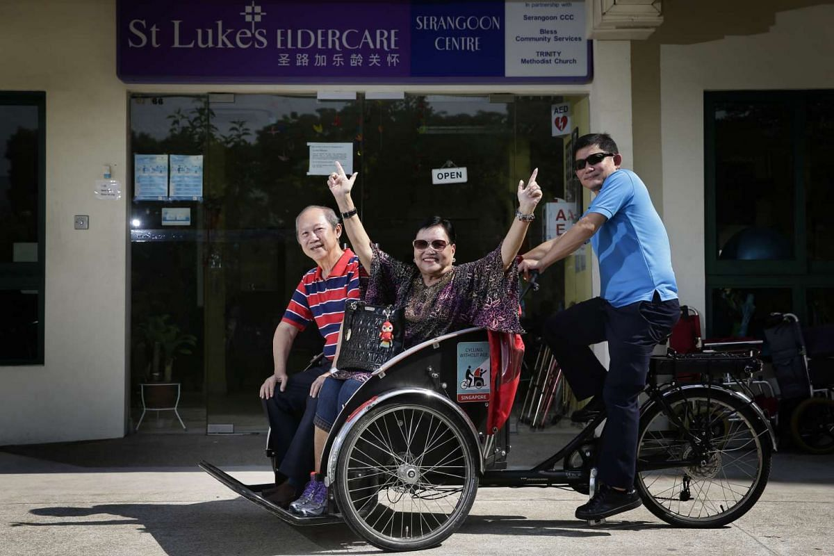 St. Luke's ElderCare Centre care staff and driver Bernard Khoo (right), with the centre's clients Mary Tong (centre), and Philip Lee (left), on the trishaw on Oct 28, 2016.