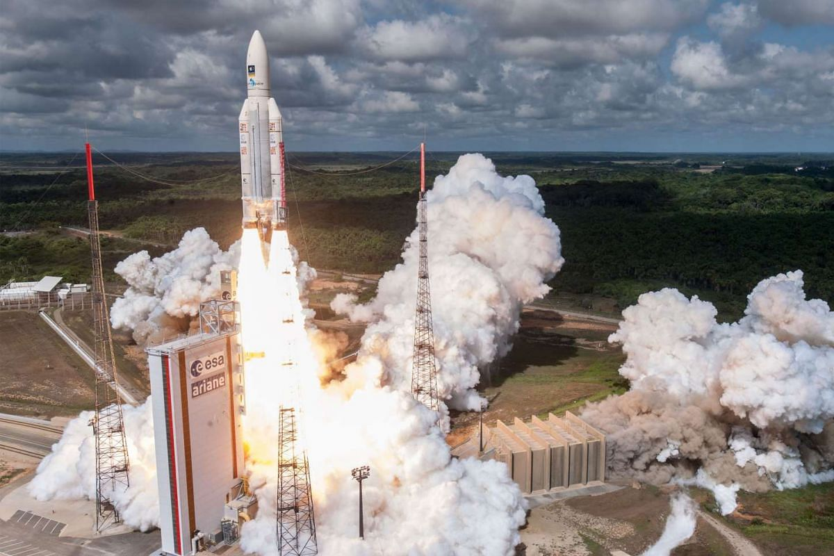 A handout photo released on November 17, 2016 shows the Ariane 5 rocket with a payload of four Galileo satellites lifting off from ESA's European Spaceport in Kourou, French Guiana. PHOTO:  AFP/ESA/CNES/ARIANESPACE/S. MARTIN