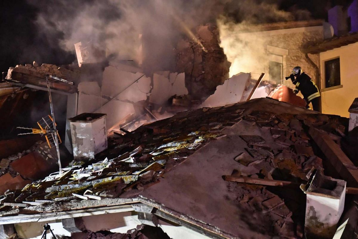 Firefighters on the scene after an explosion of a house in Bagno a Ripoli, near Florence, Italy, November 17, 2016. Two girls and their father are alive, but the search for the mother is still ongiong. PHOTO: EPA
