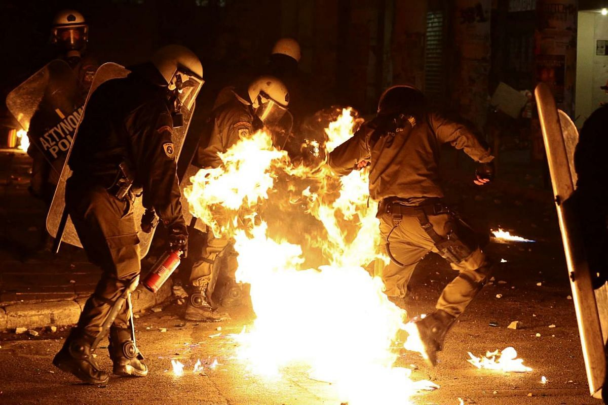 A petrol bomb explodes among riot policemen during clashes following a rally marking the 43nd anniversary of a 1973 student uprising against the military dictatorship that was ruling Greece, in Athens, Greece, November 17, 2016. PHOTO: REUTERS