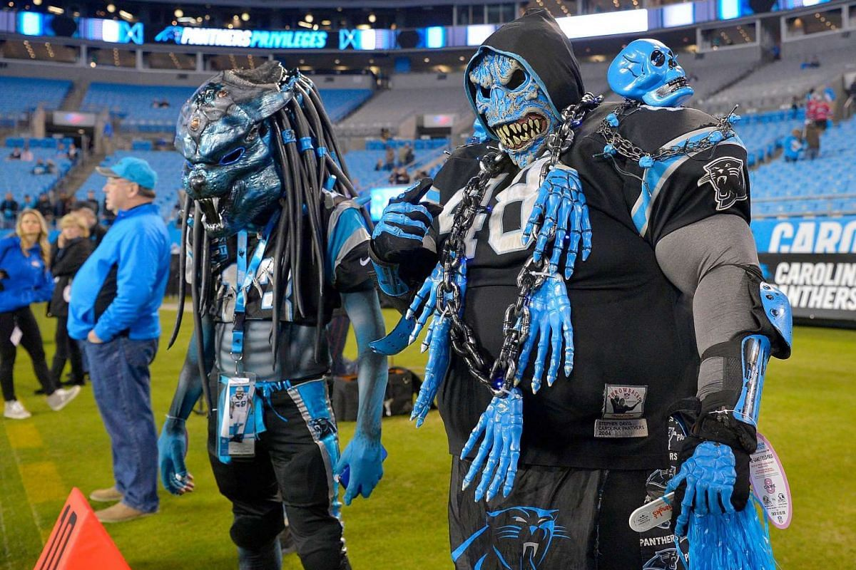 Two Carolina Panthers fans prowl the sidelines during pregame warm ups between the Carolina Panthers and the New Orleans Saints at Bank of America Stadium on November 17, 2016 in Charlotte, North Carolina. PHOTO: GETTY IMAGES/AFP
