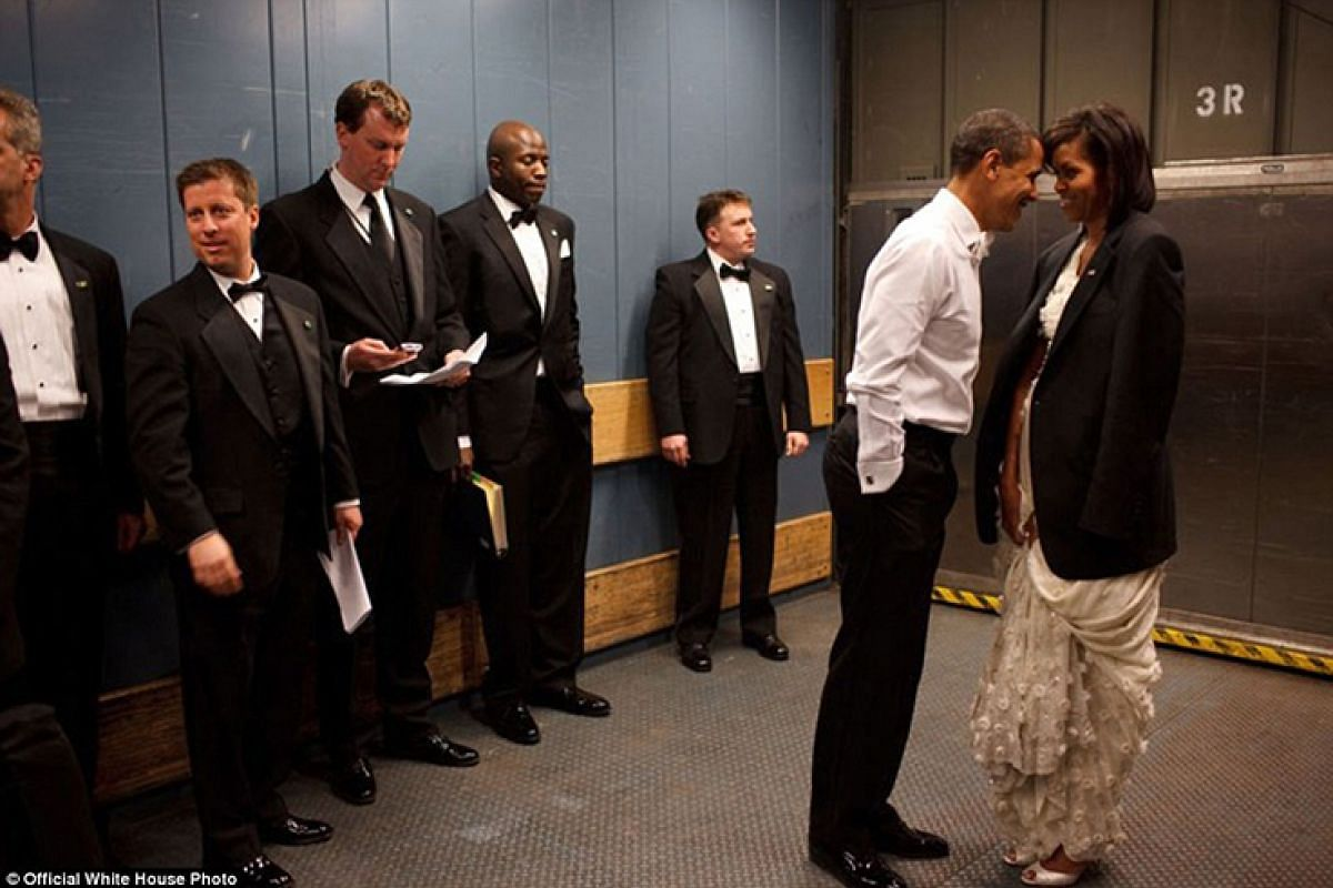 President Barack Obama and First Lady Michelle Obama share a private moment in a freight elevator at an Inaugural Ball in Washington, DC, on Jan 20, 2009.