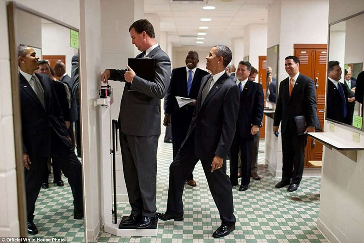 """""""We were walking through a locker room at the University of Texas when White House Trip Director Marvin Nicholson stopped to weigh himself on a scale. Unbeknownst to him, the President was stepping on the back of the scale, as Marvin continued to sli"""