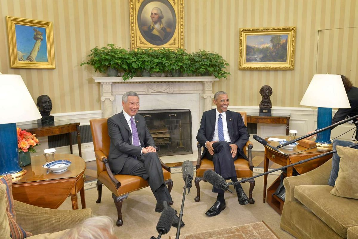 Prime Minister Lee Hsien Loong and United States President Barack Obama chatting in the Oval Office, acknowledging the crowd as they walked to their meeting at the White House, and taking the stage during the state arrival ceremony on the South Lawn