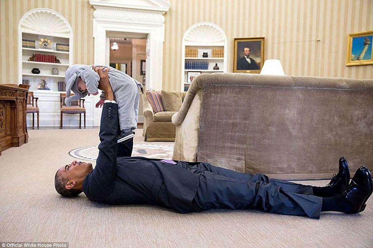 President Barack Obama visits with Ella Harper Rhodes, daughter of Ben Rhodes, Deputy National Security Advisor for Strategic Communications, in the Oval Office on Oct 30, 2015.