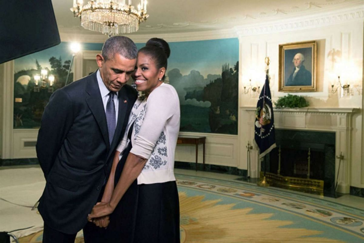 First Lady Michelle Obama snuggles against President Barack Obama before a videotaping in the Diplomatic Reception Room of the White House, on March 27, 2015.