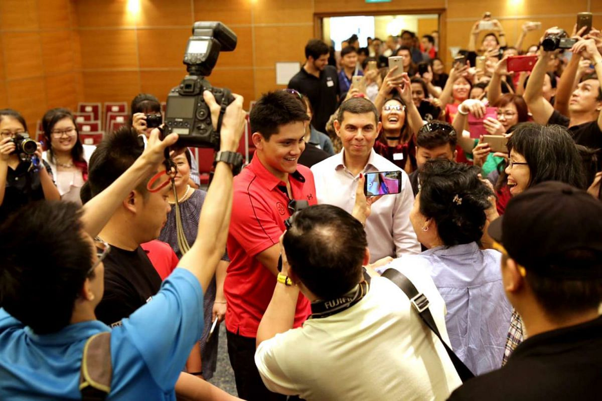 Joseph Schooling greets supporters at a book signing event at the Singapore Press Holdings News Centre on Nov 21, 2016.